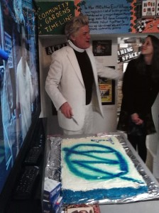 Reverend Billy of the Church of Stop Shopping cuts the cake to celebrate the 1 year anniversary of MORUS.