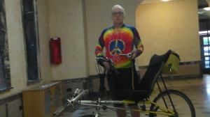 This is me in my semi-formal bike shirt standing with my 10,000 mile bike