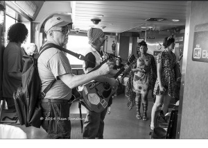 me onboard the ferry to Staten Island trying to tune a low E. Picture courtesy of Resa Sunshine.