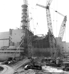 Building a concrete sarcophagus over the Chernobyl plant. Total deaths from radiation exposure estimated at 985,000 as of 2007.