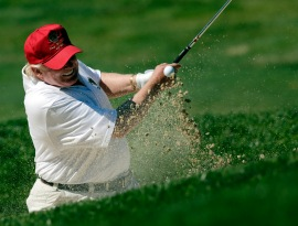 Donald Trump hits out of a sand trap on the 15th hole during a pro-am round of the AT&T National golf tournament at Congressional Country Club, Wednesday, June 27, 2012, in Bethesda, Md. (AP Photo/Patrick Semansky)